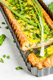 Quiche lorraine with spinach and green onion Stock Images