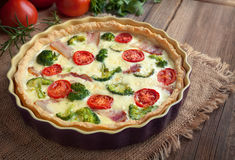 Quiche lorraine tart pie with broccoli, bacon, cheese and tomatoes Royalty Free Stock Photo