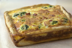 Quiche Lorraine - traditional French cake with ham, broccoli, on Stock Images