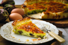 Quiche with mushrooms and artichokes. On table, close up view Royalty Free Stock Photography