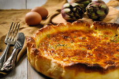 Quiche with mushrooms and artichokes. On table, close up view Stock Photography