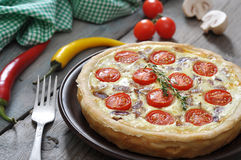 Quiche pie with chicken and cherry tomato Royalty Free Stock Photography