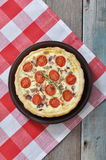Quiche pie with chicken and cherry tomato Royalty Free Stock Photos