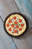 Quiche pie with chicken. Traditional french quiche pie with chicken and cherry tomato  on a plate Stock Photos