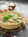 Quiche pie with fish and nettles. On the table Stock Photography
