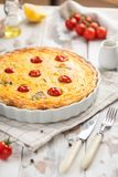 Quiche pie with mushroom in ceramic mold stock photography