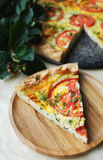 Quiche or pie with tomatoes Royalty Free Stock Photography