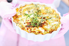 Quiche and pink apron Royalty Free Stock Images