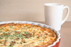 Quiche on a plate. Very shallow DOF Stock Image