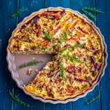 Quiche Provencal. Decorated with thyme royalty free stock photos