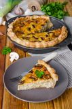 Quiche on puff pastry with leek, meat and mushrooms. Rustic style stock images