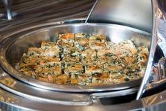 Quiche with red onion, spinach, mozzarella and arugula Stock Image