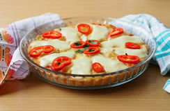 Quiche with red pepper on the table Stock Photography