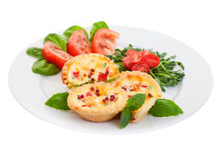 Quiche with Salad. Plate of Mini quiche on a white background filled with vegetables with salad.Focus on the front pies Stock Images