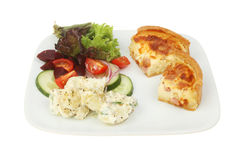Quiche and salad. Quiche Lorraine and salad on a plate isolated against white Stock Images