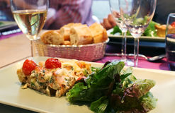 Quiche with salad and  wine Royalty Free Stock Photo