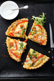 Quiche with salmon on tray royalty free stock image