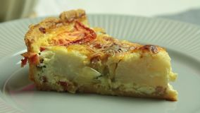 Quiche slice on plate. From cooking quiche food recipe set stock video footage
