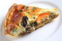 Quiche slice on a white plate Royalty Free Stock Images