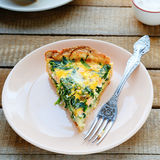 Quiche with spinach and salmon royalty free stock photo