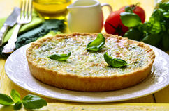 Quiche with spinach. Stock Photos