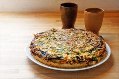 Quiche with spinach and vegetables on wood Royalty Free Stock Photography