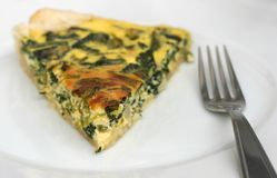 Quiche with spinach, vegetarian lunch Royalty Free Stock Image