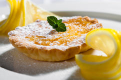 Quiche tart. With bacon and cheese served with fresh lemons Royalty Free Stock Photography