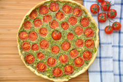 Quiche with tomato and spinach Royalty Free Stock Photo