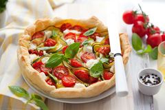 Quiche with tomato and zucchini Royalty Free Stock Photo