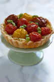 Quiche with tomatoes Stock Image
