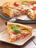 Quiche with tomatoes and zucchini Stock Photos