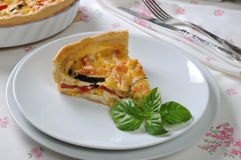 Quiche with zucchini and tomato baked cheese Royalty Free Stock Images