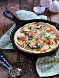 Quiches with bacon, zucchini and mushrooms Stock Images