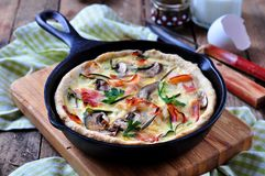 Quiches with bacon, zucchini and mushrooms Royalty Free Stock Image
