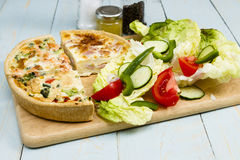 Quiches. Three different slice taken quiche Lorraine, vegetarian, salmon and broccoli with a salad stock photography