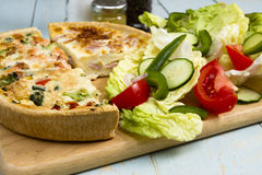 Quiches. Three different slice taken quiche Lorraine, vegetarian, salmon and broccoli with a salad stock photos