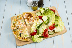 Quiches. Three different slice taken quiche Lorraine, vegetarian, salmon and broccoli with a salad royalty free stock photos