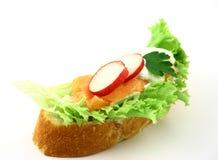 Quick breakfast. Sandwich with salmon, radish, iceberg lettuce piece of parsley and tzatziki Royalty Free Stock Photo