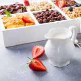 Quick breakfast cereals. Milk jug and quick cereals with berries in white wooden box, healthy breakfast concept, selective focus, copy space Royalty Free Stock Photo