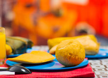 A quick breakfast contain empanada and bolon served on a blue plate, traditional andean food concept.  Stock Image