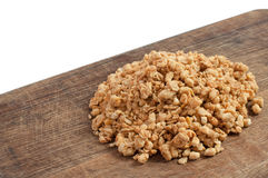 Quick breakfast of granola on a wooden board. Quick and tasty breakfast of granola on a wooden board l royalty free stock images