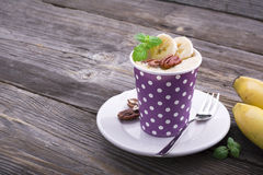 Quick breakfast in the microwave for five minutes. Homemade banana cup cakes in paper cups  portioned snack. two Stock Image