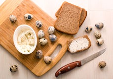 Quick Breakfast - quail eggs, rye bread and cheese Stock Images