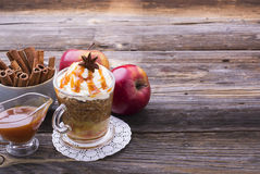 Quick breakfast snack for a few minutes in the microwave. Traditional apple pie in  mug with whipped cream quickly. Quick breakfast snack for a few minutes in Stock Images