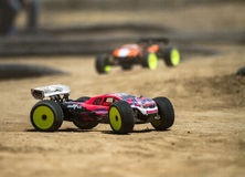 Quick cars race each other Stock Image