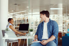 Quick catch up between colleagues Stock Photos
