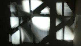 Quick changing flashing window frame shadow. Quick changing window frame shadow with sunlight, black and white stock footage