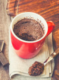 Quick chocolate cake in a mug. Chocolate cake in a mug. Vintage toned picture Royalty Free Stock Image
