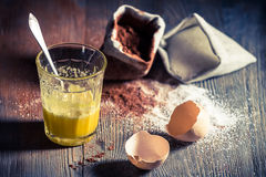Quick dessert composed of egg and sugar. On old wooden table royalty free stock image